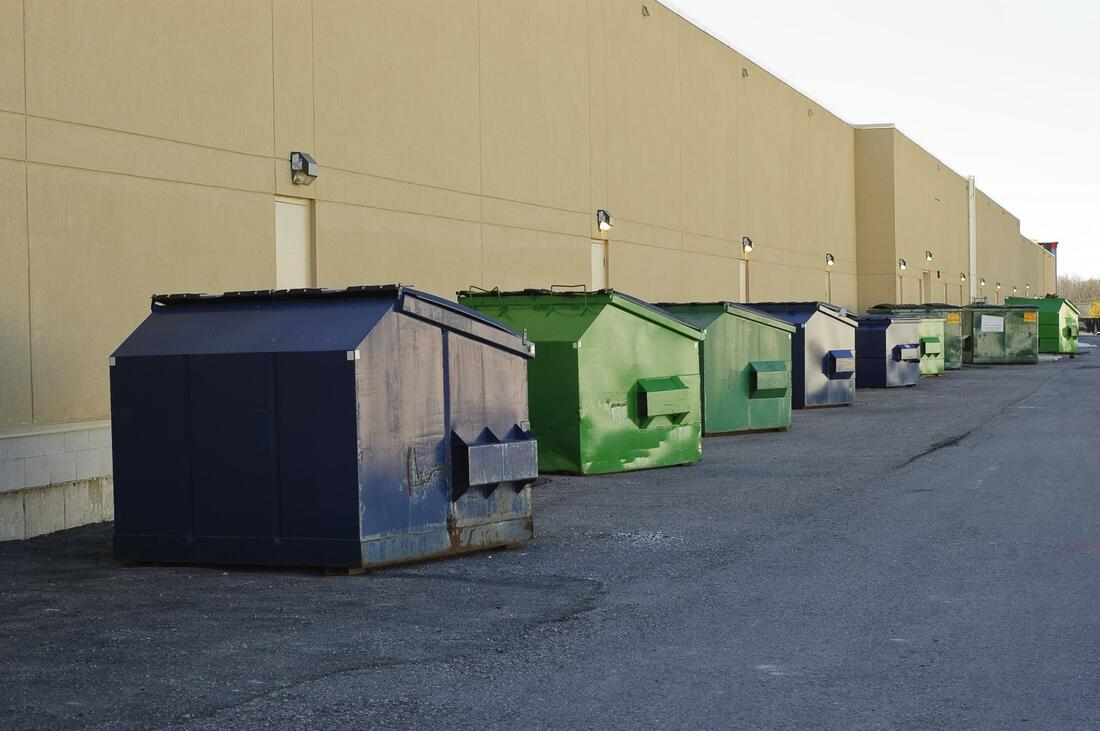 A line of dumpsters for rent